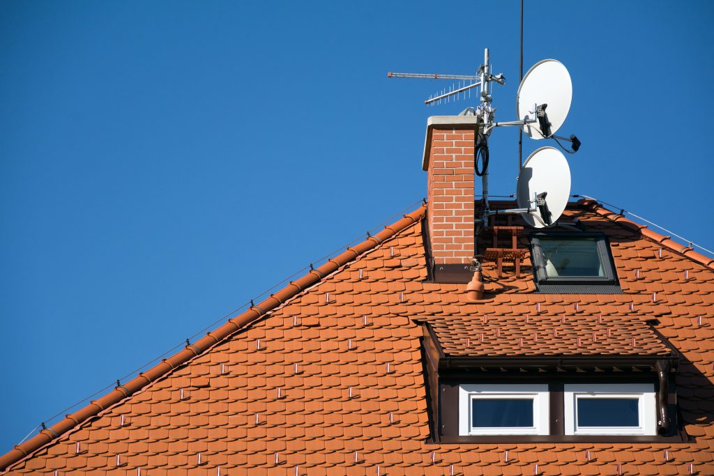 Roof installation of satellite dish and aerial